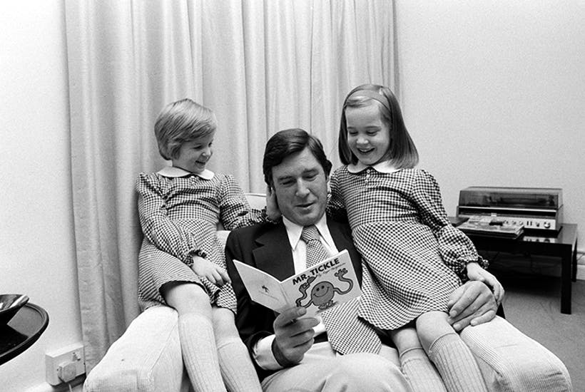 Roger Hargreaves reading to his twin daughters. Credit: Getty Images