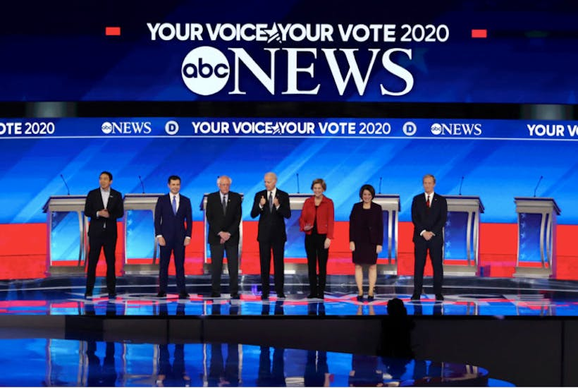 Andrew Yang, Pete Buttigieg, Bernie Sanders, Joe Biden, Elizabeth Warren, Amy Klobuchar and Tom Steyer at the DNC debate in Manchester, New Hampshire