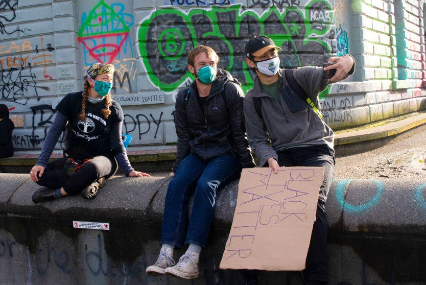Friends take a selfie in the the Capitol Hill Autonomous Zone (CHAZ) in Seattle, Washington